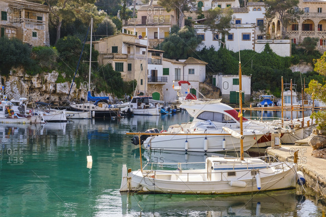 Spain- Mallorca- Santanyi- Boats moored in harbor of coastal village in summer