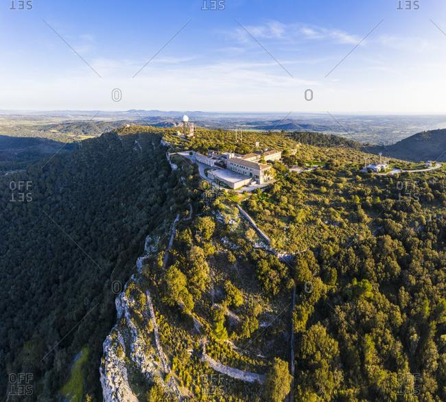 Spain- Mallorca- Drone view of Santuari de Nostra Senyora de Cura and Puig De Randa mountain in summer