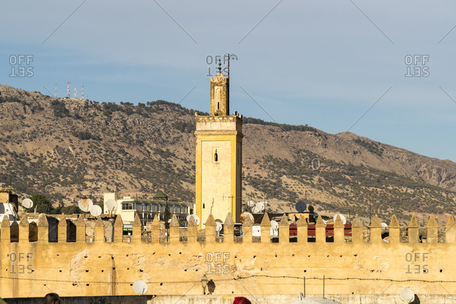 Morocco- Fes-Meknes- Fes- Minaret behind wall of Bab Chems city gate