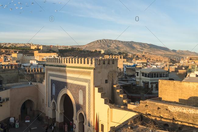 Morocco- Fes-Meknes- Fes- Bab Bou Jeloud city gate at dusk