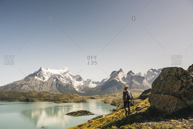 Mature man walking by lake against clear sky at Torres Del Paine National Park- Patagonia- Chile