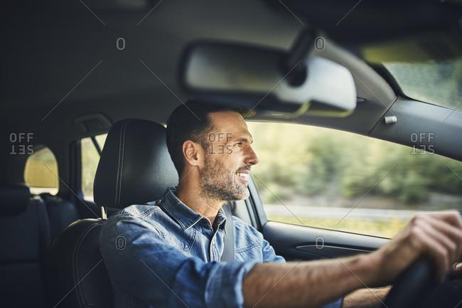 Handsome man driving a car