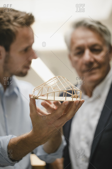 Architect presenting architectural model to client