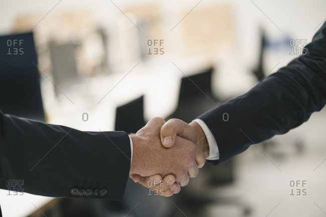 Two businessmen shaking hands after making deal
