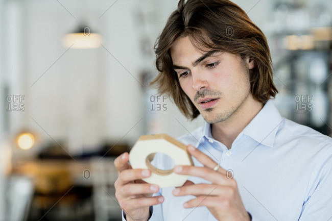 Close-up of thoughtful businessman looking at object in cafe