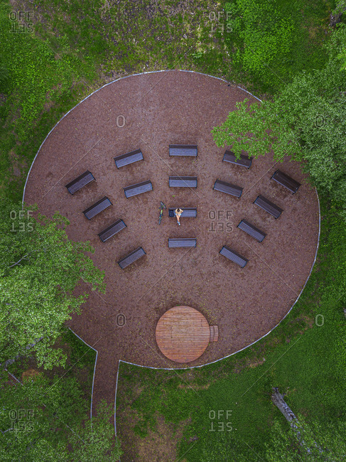 Aerial view of woman relaxing on bench in park