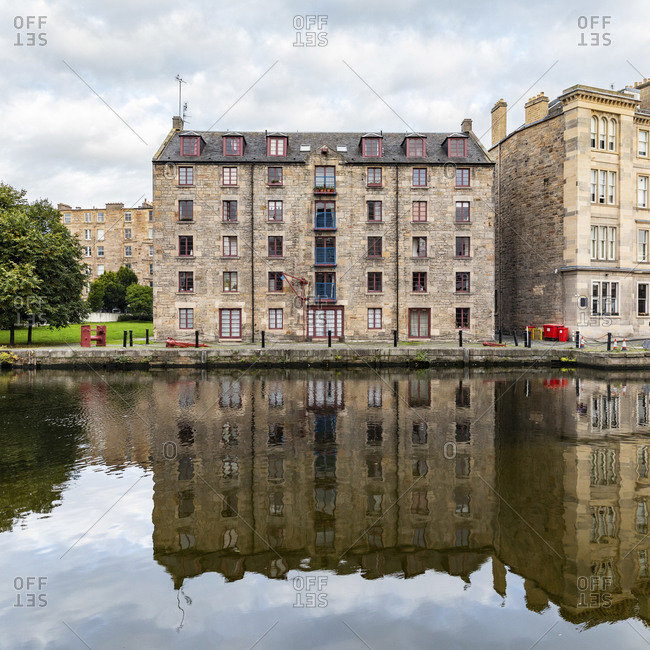 UK- Scotland- Edinburgh- Waterfront buildings and reflections on Water of Leith