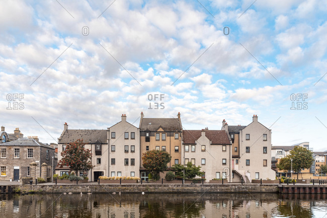 UK- Scotland- Edinburgh- Waterfront buildings and reflections on Water ofLeith
