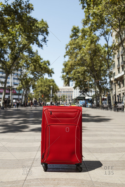 A lonely red suitcase in the popular Las Ramblas in Barcelona, Spain
