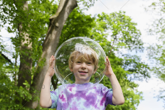 Boy wearing bubble outdoors to socially distance