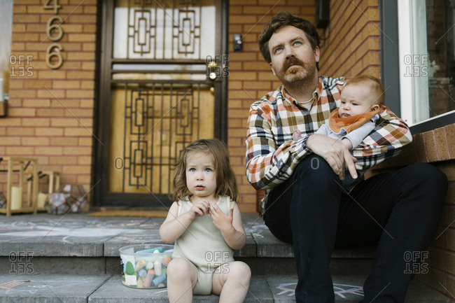 Father with kids sitting on porch