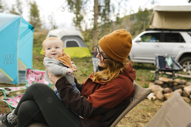 USA, Utah, Uninta Wasatch Cache National Forest, Mother holding son (6-11 months) on campsite