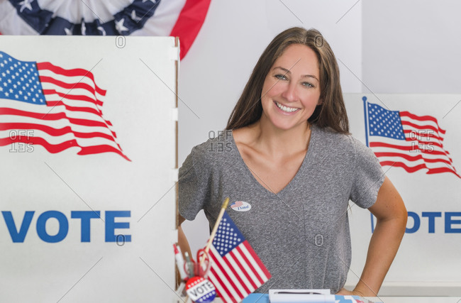 Smiling woman standing in polling place
