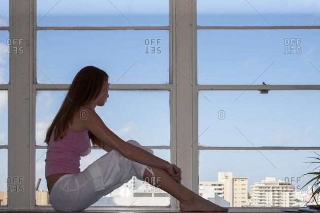 USA, Florida, Miami Beach, Young woman looking through window
