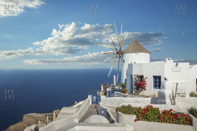 Greece, Oia, Santorini, Cyclades islands, Old windmill on waterfront
