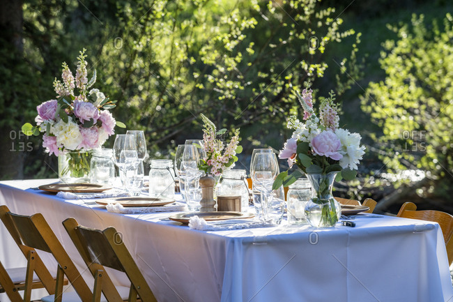 Outdoor dinner table setting for dinner party