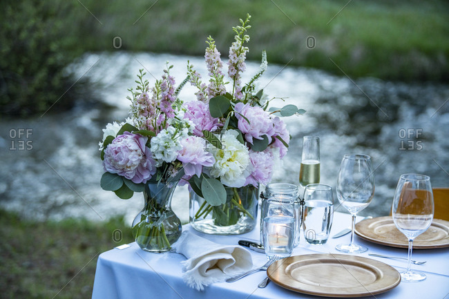 Outdoor dinner table setting with fresh flowers