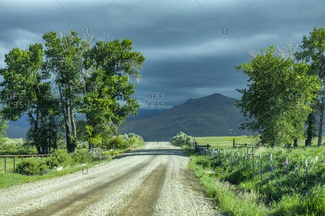 USA, Idaho, Sun Valley, Dirt road in rural landscape