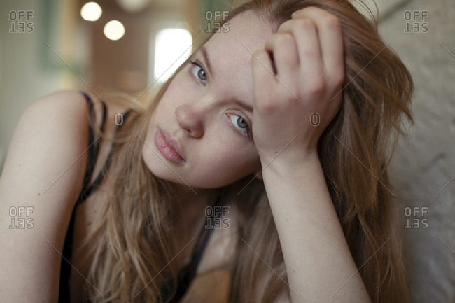 Portrait of young woman with long blond hair