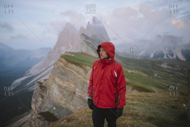 Italy, Dolomite Alps, Seceda mountain, Man hiking near Seceda mountain in Dolomite Alps