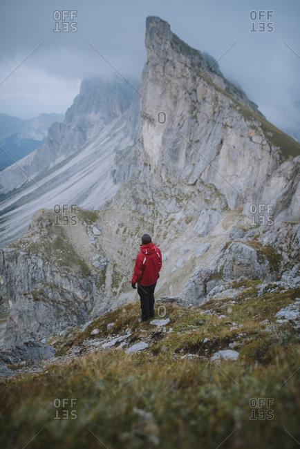 Italy, Dolomite Alps, Seceda mountain, Man hiking near Seceda mountain in Dolomites
