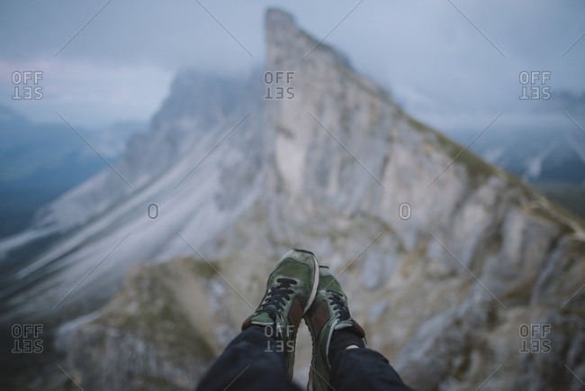 Italy, Dolomite Alps, Seceda mountain, Low section of man near Seceda mountain in Dolomites