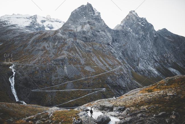 Norway, Andalsnes, Trollstigen, Man looking at scenic view of Trollstigen road