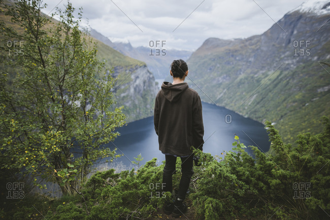Norway, Geiranger, Man looking at scenic view of Geirangerfjord