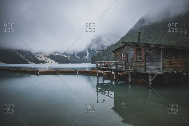 Italy, Wooden house and boats at Pragser Wildsee