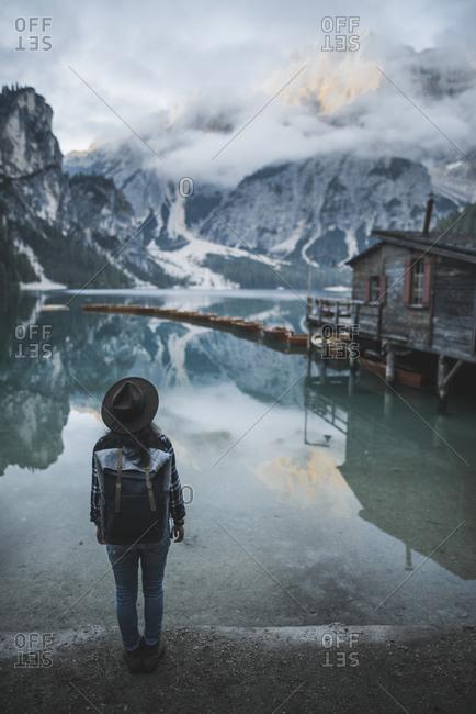 Italy, Woman standing by Pragser Wildsee in Dolomites
