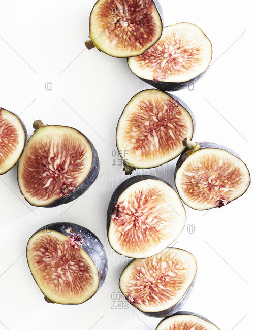Sliced figs on white background