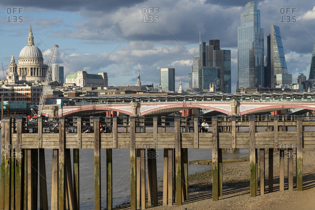 London, United Kingdom - July 6, 2020: St. Paul's Cathedral and the City of London above old wooden pilings on the Southbank of the River Thames