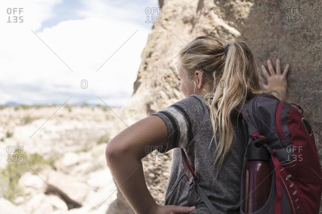 12 year old girl hiking in Tsankawi Runis, NM.