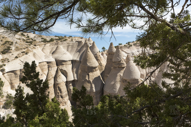 Slot canyon at Kasha Katuwe and view across to the Tent Rocks and rows of eroded rock pillars.