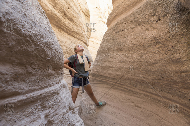 12 year old girl hiking in beautiful slot canyon, Kasha Katuwe, Tent Rocks, NM.