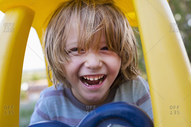 Portrait of 5 year old boy with his toy car