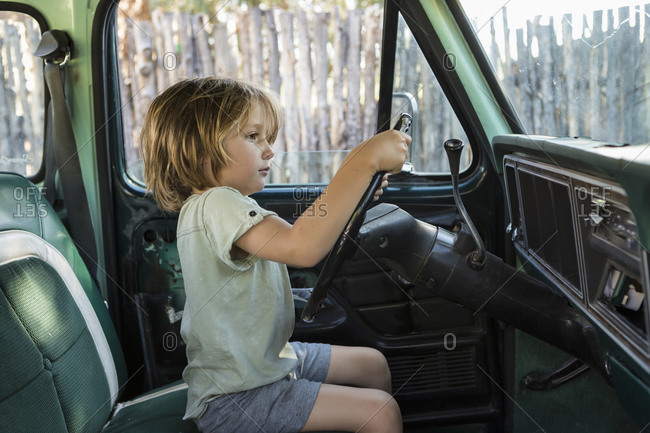 5 year old boy behind the wheel of 1970's pick up truck, NM.