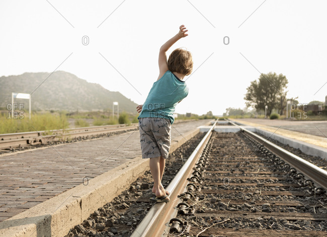 4 year old boy balancing on railroad track, Lamy, NM.