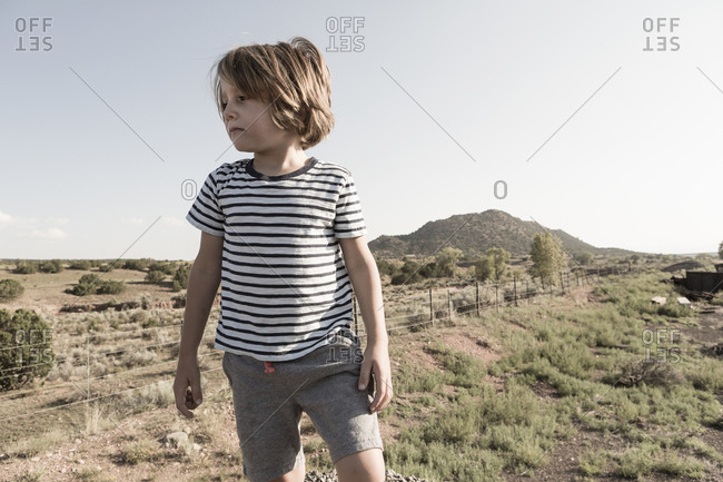 4 year old boy playing on railroad tracks, Lamy, NM.