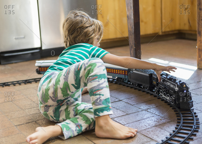 4 year old boy playing with toy train
