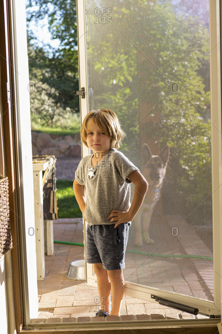 Portrait of 4 yr old boy on his front porch