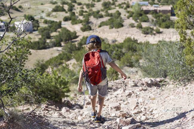 4 year old boy hiking in rural landscape, Lamy, NM.