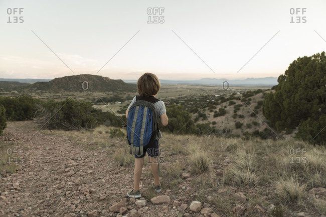 4 year old boy hiking at sunset, Lamy, NM