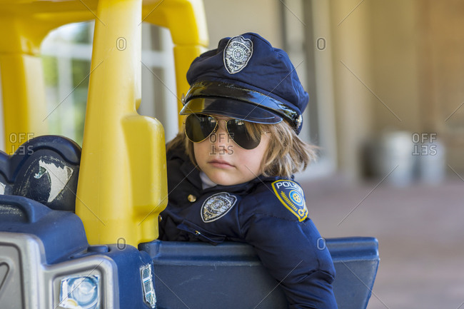 4 year old boy dressed as a police officer