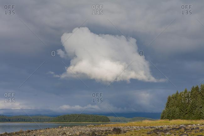 Dramatic storm clouds over remote coastline, Muir Inlet, Glacier Bay National Park and Preserve, Alaska