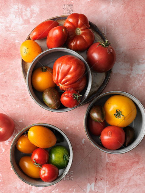 Heirloom tomatoes on pink background