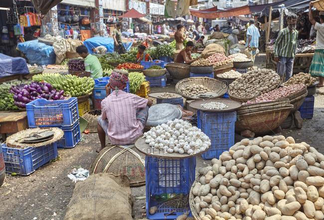 Dhaka, Bangladesh - April 28, 2013: Produce vendors at the Kawran Bazar