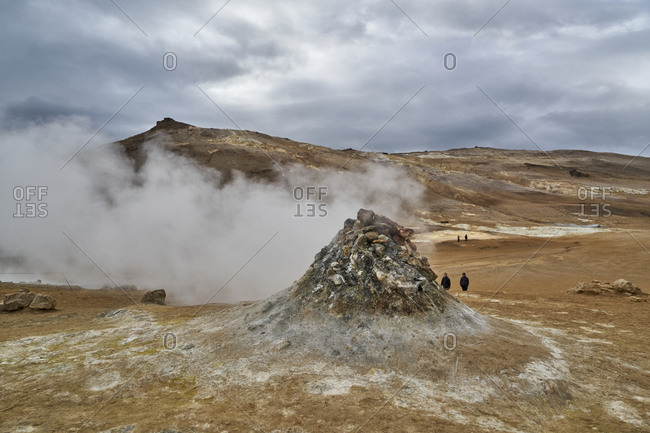 Hverir geothermal spot with steaming fumaroles emitting sulfuric gas in Iceland