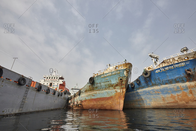 Dhaka, Bangladesh - April 27, 2013: Large cargo ships in the Dhaka Shipyard located on the riverbank of the Buriganga River