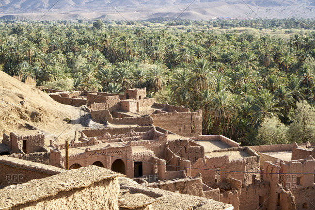 High angle view of the ruins of the Kasbah of Tiliouine located in a palm oasis near Agdz, Morocco